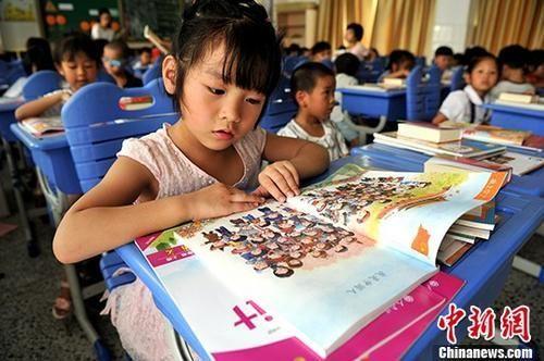 中国义务教育年投入超2万亿 15年免费教育暂不可行